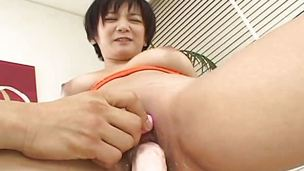 Asian busty slattern tries out the sex toy