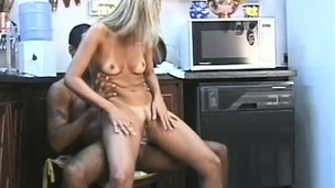 Nearly the kitchen, a horny tow-headed housewife gets screwed hard in both holes