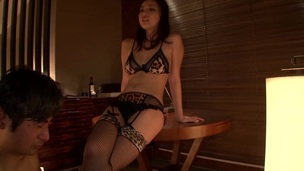 Japanese brunette in bra and stockings performs hot cook jerking