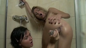 Hot young lesbians banging each other's holes relative to dildos near rub-down the shower