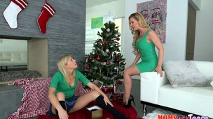 Pussy loving gals lick that beaver next to the Christmas tree